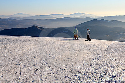 Mountain-skiers on the top of mountain.