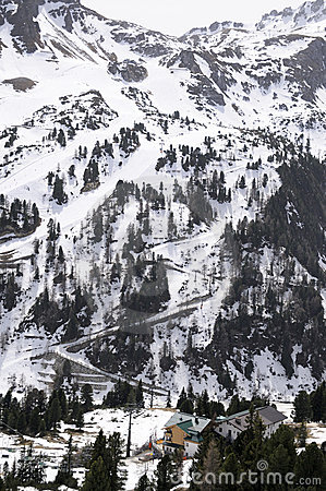 Mountain slope under snow with ski lifts in Alps
