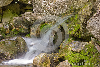 Mountain stream with cascading waterfalls
