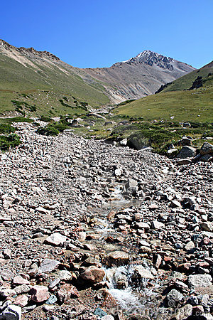 Mountain stream among stones and pebbles,Tien-Shan