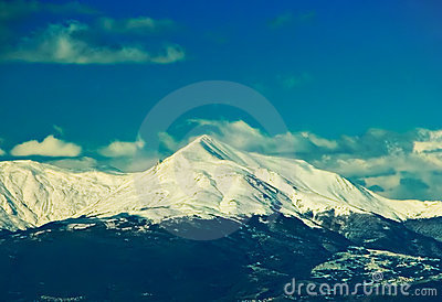 Mountain top under snow