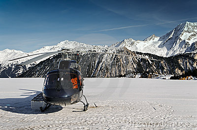 Mountain touristic helicopter in flight