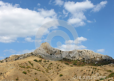 Mountain under blue cloudy sky