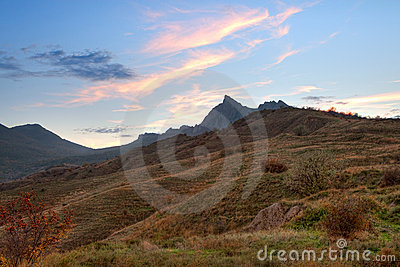 Mountain valley with cloudy sky sunset