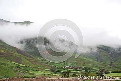 Mountain village in fog