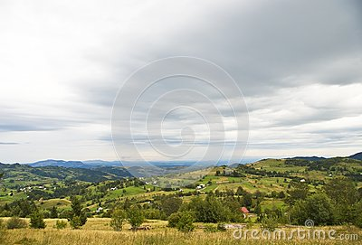 Mountain village landscape with dramatic sky