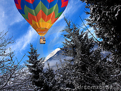 Mountain in winter time and balloon