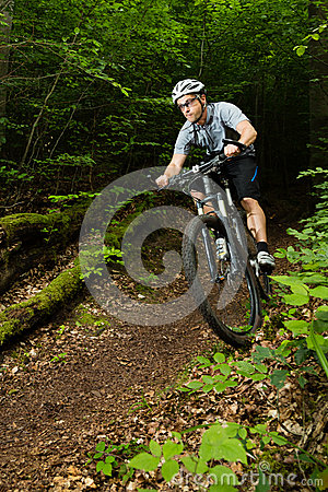 Mountainbiker driving through a curve