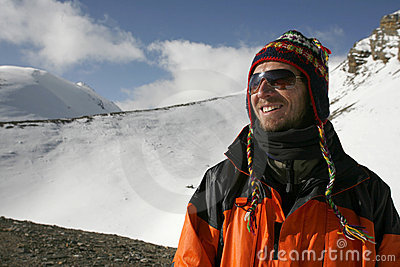 Mountaineer enjoying the summit after a climb up