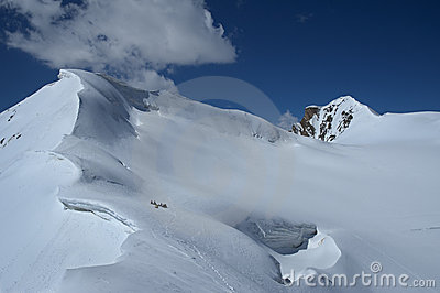 Mountaineering team near grand snow carnice
