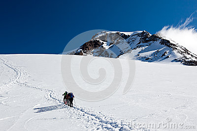 Mountaineers walking on Monte Rosa Glacier