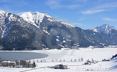 Mountains, frozen lake and village