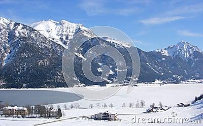 Mountains, frozen lake and village
