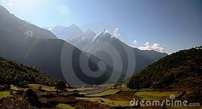 Mountains and green fields of the Everest