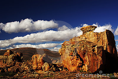mountains & red desert stones