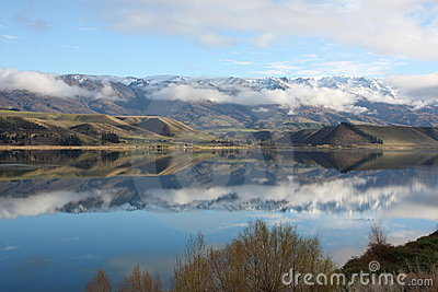 Mountains reflected in Lake Dunstan New Zealand