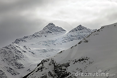 Mountains in snow in cloudy weather