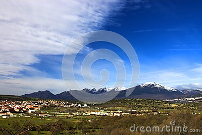 Mountains, village and a blue sky