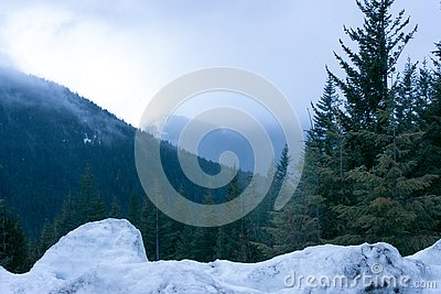 Mountains in the winter hiding in the fog. Stock Photo