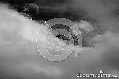 Mountaintop through clouds