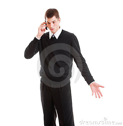 Mournful businessman talking on the phone