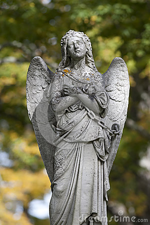 Mournful statue of chained angel
