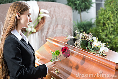 Mourning Woman at Funeral with coffin