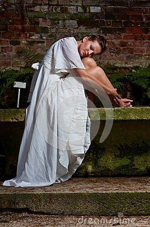 Free Mourning Woman White Dress Sitting Stone Bench Royalty Free Stock Photos - 33257448