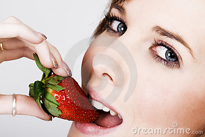 Mouth with fresh strawberry
