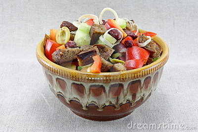Mouthwatering salad of bread, tomatoe, beans