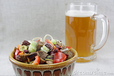 Mouthwatering salad and a glass of beer