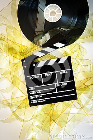 Free Movie Clapper On 35 Mm Cinema Reel Unrolled Yellow Filmstrip Royalty Free Stock Photo - 53648215