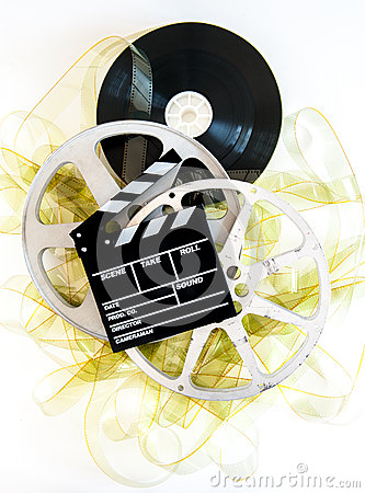Free Movie Clapper On 35mm Yellow Unrolled Film And Cinema Reels Royalty Free Stock Photo - 53436965