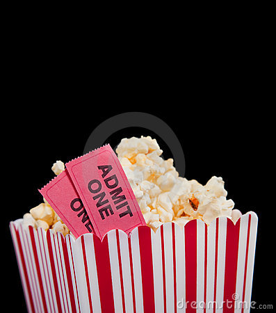 Movie ticket and popcorn on a black background