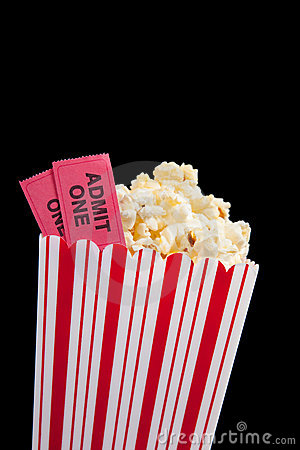 movie ticket and popcorn on a black background royalty
