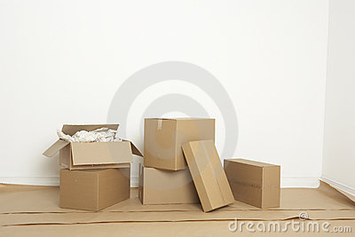Moving boxes inside a newly painted room