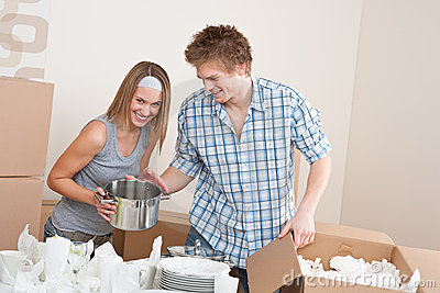 Moving house: Young couple unpacking