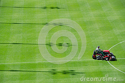 Mowing grass Editorial Stock Photo