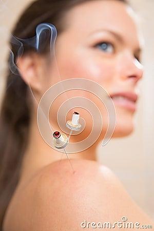 Moxibustion acupunture needles heat on woman