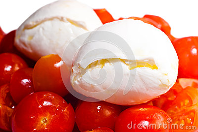 Mozarella cheese on top of red tomatoes