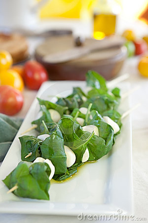 Mozzarella cheese with basil in skewers