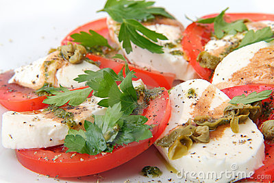 Mozzarella with fresh basil and capers sauce