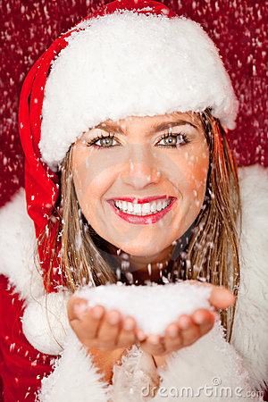 Mrs. Claus under falling snow
