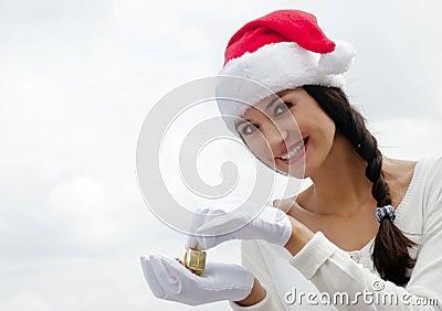 Mrs. Santa with a gift box.