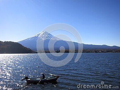 Mt. Fuji with a Boater Out on Lake in Front of Mountain