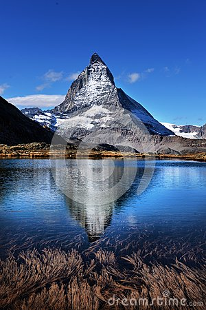Free Mt Matterhorn Reflected In Riffelsee Lake Zermatt Canton Of Vala Stock Photo - 103989980