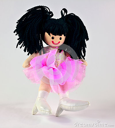 Muñeca hecha a mano del juguete en rosa