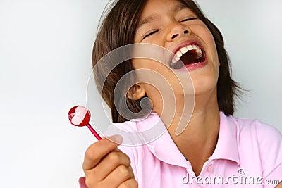 Muchacha feliz del lollipop