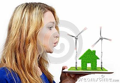Muchacha que sopla en las turbinas de viento