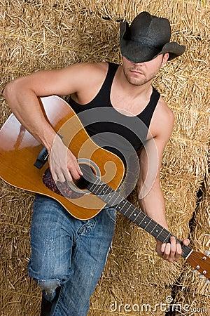 Muchacho de la guitarra del país